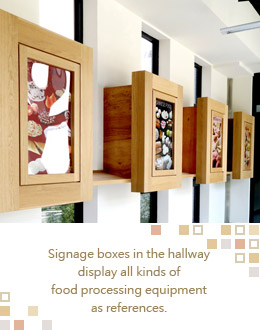 Signage boxes in the hallway display all kinds of food processing equipment as references